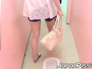 Kinky Asian cuties have fun peeing in public toilet