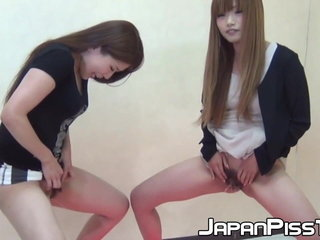 Shy Japanese honeys demonstrate off hairy pussy while pissing