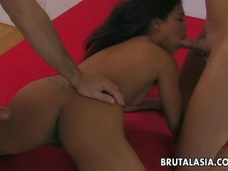 Asian slut with a tramp stamp fucks in a thre